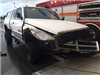White Truck with Damage to the Front by a Fire Truck