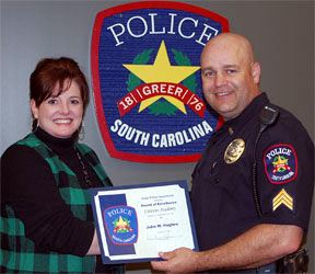Officer and woman with Citizens Police Academy Certificate