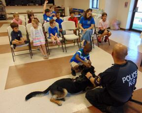 Young boy petting one of the K-9 dogs