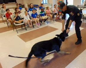 K-9 Boss playing with officer